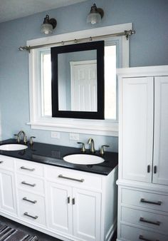 White Bathroom Cabinets With Dark Countertops the master bathroom has black granite countertops with double