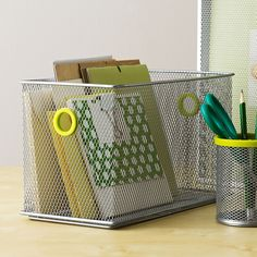 Plop this functional bin on your desktop to easily access files, office supplies, and more. Sleek and modern, it also adds a note of style to your workspace.  Find the Wire Storage Bin, as seen in the Clear Your Clutter Collection at http://dotandbo.com/collections/clear-your-clutter?utm_source=pinterest&utm_medium=organic&db_sku=DIM0178