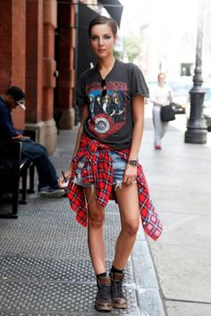 Rock n roll tee with a plaid shirt tied at waist and a pair of jean short shorts, with laced up boots...perfect for a concert in summer