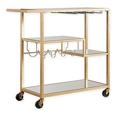 With its dramatic gold finish, the Georgina Bar Cart from Verona Home adds eye-catching appeal to your home. The mirrored shelf surfaces provide 4 wine glass racks and dedicated bottle storage making it easy to entertain. Casters allow for easy movement.