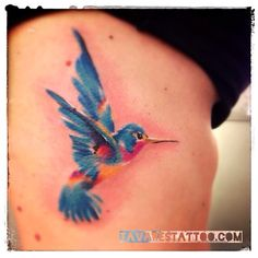 Watercolor hummingbird tattoo done by Tavarestattoo.com
