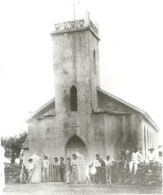 14. An undated photograph 14. of Kalawao men in front of St. Philomena Church.