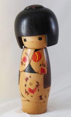 Sweet Kokeshi with tilted head