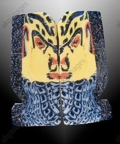 DEMON MASK / EGYPTIAN GLASS TABLET. Egyptian, Ptolemaic period, 1st century B.C.  Two glass tablets with demon mask.  Coloured glass, each 3.2 × 1.5cm. London art dealer, Christie's (1993).