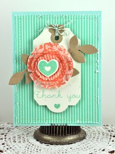 Cute card with the layers of designer paper and the heart