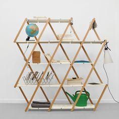 Concertina expanding shelving for flexible storage with scissor frame by Stephanie Hornig.
