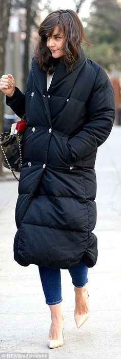 After playing a lawyer in Batman Begins, the verdict on Katie Holmes's coat has to be quilty