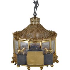 """Etched Crystal and Bronze Carousel Form Musical Jewelry Box  French  Circa 1900  With horses and circus motif, figural finial. With incised """"Cirque de Paris"""" on facade."""