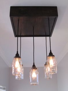 Hey, I found this really awesome Etsy listing at https://www.etsy.com/listing/185592935/handcrafted-square-mason-jar-ceiling