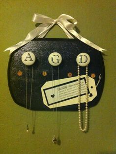 Just screw some drawer pulls to one of those wooden plaques you can get at Michaels and instant necklace hanger! AGD style for my Alpha Gam fam!