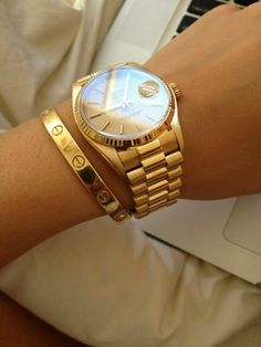 Gold watch with a Cartier Love bracelet. Classic every day, every night look.