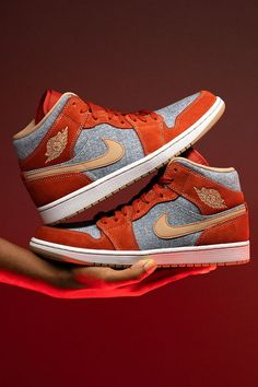 The Air Jordan 1 Mid gets a perfect look for fall with this new premium edition featuring panels in blue denim and dark red suede along with tan nubuck detailing. Grab your pair now before everybody else catches on to how clean these are.
