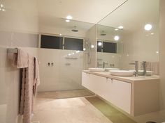Wall hung vanity with waterfall benchtop. Simple but clean  would work well with timber flooring in hallway.