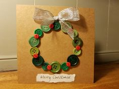 Handmade Christmas card with buttons and silver bow Button Christmas Cards, Christmas Buttons, Christmas Card Crafts, Button Cards, Homemade Christmas Cards, Christmas Ornaments To Make, Homemade Cards, Handmade Christmas, Xmas Cards Handmade