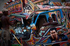 Port-au-Prince, Haiti: Blanc Dalefre poses for a portrait with his bus decorated with an image of the Argentinian footballer Lionel Messi