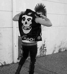 Male punk with a mohawk, The Misfits vest, bullet belt