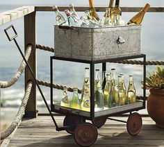 Galvanized Metal Rolling Party Bucket. If your backyard is extremely spacious, or you just want something festive and quality to display the array of cervezas on hand– consider this portable choice