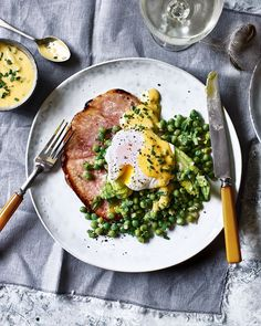 We've given gammon steaks a new lease of life by grilling them in a honey-mustard glaze and serving with a herby hollandaise, poached eggs and fresh peas. Heaven.