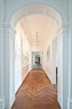 Great white hallway with great architecture and herringbone wood floors would like to incorporate this design somehow in the interior design Arch Doorway, Entrance Foyer, Entry Hallway, Hallway Ideas, Grand Entrance, Houses Architecture, Architecture Details, Staircase Architecture, Modern Staircase