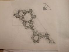 Weird Gasket Fractal.  Created by taking a quarter-hexagon rep-tile (shown above), cutting out the bottom left of its 4 identical component pieces, and repeating the pattern ad nauseum.