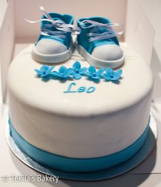 Christening cake to Leo with baby blue shoes and flowers