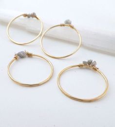 Thin golden rings with crystals and precious gem stones.
