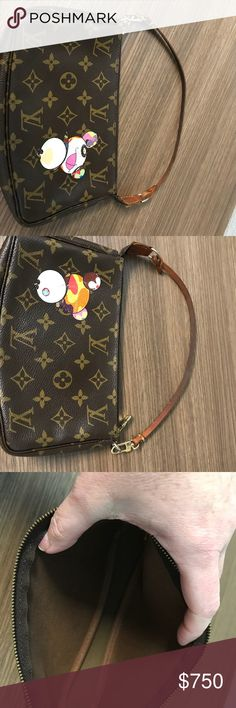 """Takashi Murakami monogram Louis Vuitton Panda From the Takashi Murakami Collection. Brown and tan monogram coated canvas Louis Vuitton Panda Pochette Accessoires with brass hardware, tan vachetta leather accents, flat top handle, brown canvas lining and zip closure at top. Date code reads VI0094.  Handle Drop: 6"""" Height: 6"""" Width: 9"""" Depth: 1"""" Condition: Very Good. Minor oxidation and marks at leather trim; faint scratches and tarnish at hardware; slight wear at interior. Louis Vuitton Bags"""