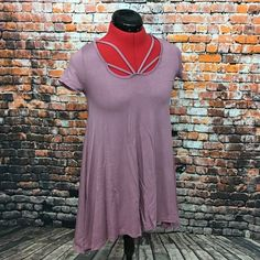 🎉HP🎉Thankyou @kaesbass. April Spirit Tunic/Dress Soft rose pink Strappy dress/tunic with Assymetrical hem line. 95% Rayon 5% Spandex. Made in the USA. True to size. Brand new from April Spirit.  I feel though that it is more of a tunic b c the length would be too short for a dress (you can see the pic of me wearing it.) It is very comfy though like a soft t-shirt. And the Strappy detail is super cute & trendy! April Spirit Dresses Asymmetrical