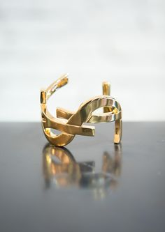 YSL Cuff...it just keeps getting better #accessories #YSL #YvesSaintLaurent