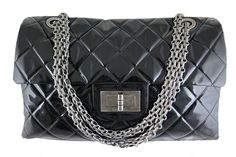 Chanel Reissue Xxl Jumbo Black Patent Limited Edition Bag - Rare - This is by far the largest reissue bag ever produced by Chanel. Extremely rare as it was only released in limited quantities. This piece is in excellent condition with no visible stains or scratches on the exterior. Patent leather is smooth and buttery to the touch. The chains can be worn long across the body or doubled on the shoulders. Aged silver chains and hardware are in good condition. Features a back pocket, an inner…