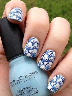 blue sky and cloud nail art