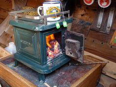 Navigator Stove works has been building quality (made in the USA) tiny cast iron wood stoves since They are specifically made for boats but have been used for many other applications like RV'… Mini Wood Stove, Tiny House Wood Stove, Small Wood Burning Stove, Small Stove, House Heater, Stove Heater, Cooking Stove, Basic Kitchen, Into The Woods