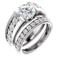 The near-colorless quality of this genuine and brilliant diamond ring is captivating. The center diamond on the engagement ring is 2.0 carats and the smaller ro
