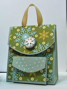 I finally got all the pictures and instructions together for this promised tutorial for these fun little back packs.   Several people have p...