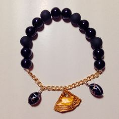 My first bracelet: black pearls, golden plated chain and bronze nespresso capsule