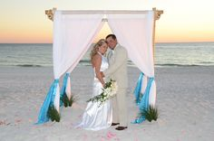 Get married with a bamboo wedding arbor as your beach wedding backdrop, photo by Sunshine Wedding Company.