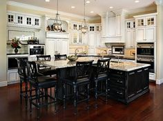 Dream Kitchen - love the white cabinets with black island!