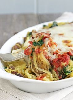Sausage, spinach, and spaghetti squash bake! An easy and satisfying low carb casserole recipe that the whole family will enjoy - perfect for those hectic weeknight dinners!