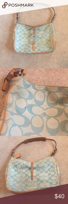 Light Blue COACH C Canvas and Leather bag Genuine COACH bag with the signature C pattern in light blue with camel/light tan leather trim and bottom and silver hardware. Clip closure and inside pocket. Smallish size. Used with some wear but could probably be cleaned up nicely at a shoe repair shop. One small hole, see pictures. Coach Bags Shoulder Bags