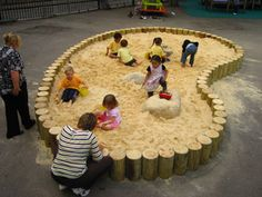 everything about this sandpit: peg borders, colour of sand, big boulders... except I'd put a mini-ramp for the crawlers