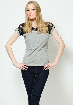 Grey coloured top for women from Oomph! Made of cotton knit fabric, this hip-length top has short sleeves and a round neck.