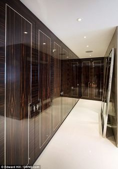 The smart polished wood wardrobes are just waiting to be filled with designer clothes when the new owners of Stratheden move in. Property price £34000000