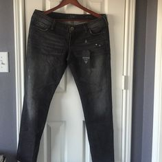 NEW LISTING! Guess black skinny jeans Brand new Beverly skinny low rise slim fit black jeans from Guess. Measurements: waist is 17 1/2 inches. Inseam is 30 inches. Price is negotiable for serious buyers. Pls use the offer button. Guess Pants Skinny