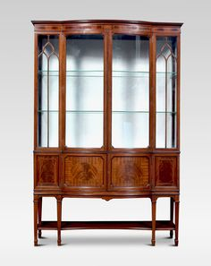 For Sale on - Edwardian mahogany bow front display cabinet. Having a pair of astragal glazed centre doors enclosing shelved and watermark silk upholstered interior, Antique Display Cabinets, China Cabinet, Cupboard Doors, Antique Photos, Carpentry, Shelving, Bows, Antiques, Storage