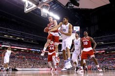 Wisconsin guard Bronson Koenig heads to the hoop for two of his 12 points Saturday night. The Badgers upset unbeaten Kentucky, 71-64.