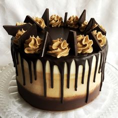 Mocha drip cake. Made with dark chocolate cake with coffee buttercream filling. On the outside there is an ombré buttercream made out of chocolate, coffee and vanilla buttercreams. Topped with chocolate ganache and 85% dark chocolate pieces. No added  colours.