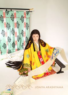 A woman dressed in junihitoe at a kimono photography experience.