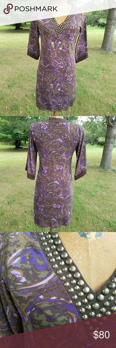 Michael Kors Patterned Dress Beautiful purple v-neck patterned sleeved dress with brass colored neckline embellishments. Polyester spandex blend. EUC no rips, stains, fading, or pilling. Nice stretch and can fit up to a size medium. Dress form in photo is a size 8. Michael Kors Dresses Midi
