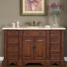 @Overstock - This vanity is impressive in stature and presence. With its hand crafted workmanship and attention to detail, this vanity will not be overlooked.  http://www.overstock.com/Home-Garden/Silkroad-Exclusive-58-inch-Marble-Stone-Top-Bathroom-Vanity-Lavatory-Single-Sink-Cabinet/6358782/product.html?CID=214117 $1,479.99