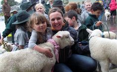 Wairarapa farmer Lynley Wyeth congratulates Rebecca Kippen-Clough, on her wonderful care of Diesel the lamb at Fernridge School's Pet Day. Town And Country, Country Living, Pet Day, School S, Lincoln, Farmer, New Zealand, Lamb, Diesel